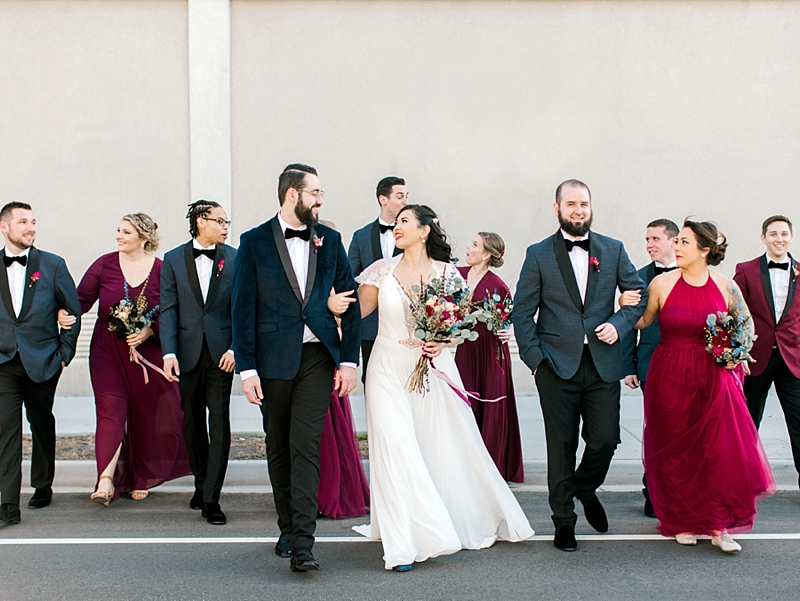 Gorgeous dark red bridesmaid dresses and blue tuxedos