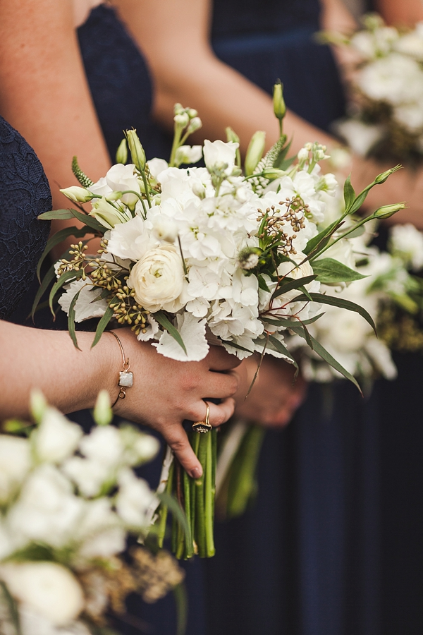 Simple white wedding bouquets with greenery for texture