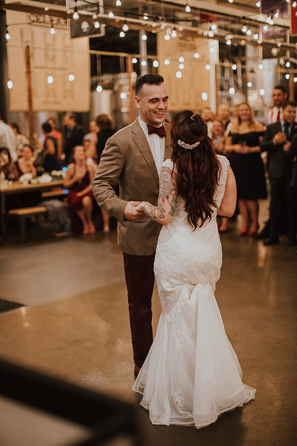 First wedding dance with bistro lights at Norfolk Virginia brewing company