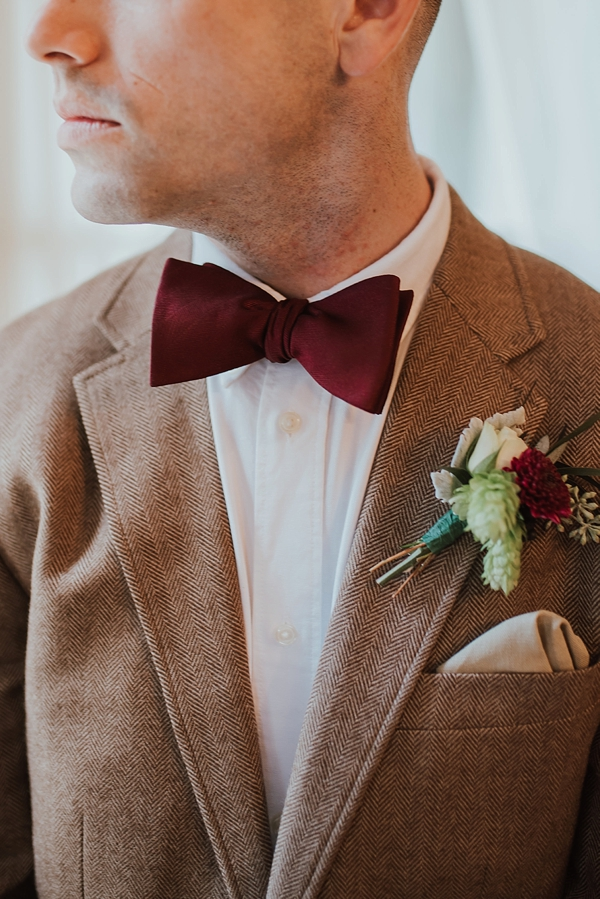 Burgundy red bow tie and vintage modern boutonniere