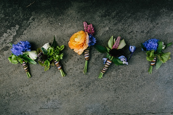 Wildflower boutonnieres with Paul Smith rainbow ribbons