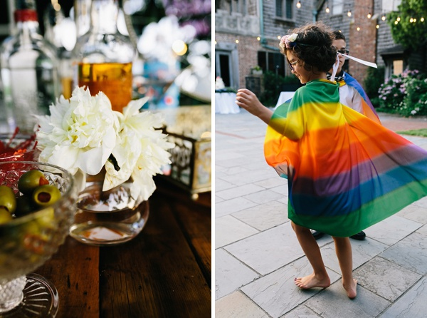 Flower girl celebrating with rainbow cape on the wedding dance floor