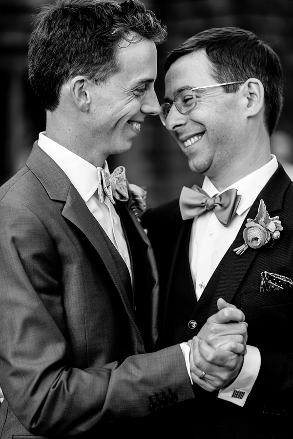 Joyful two grooms sharing their first dance