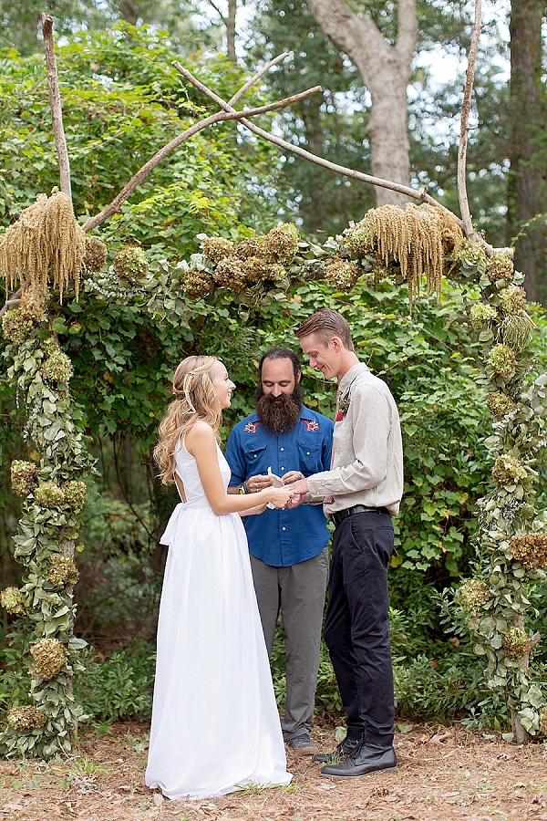 Boho wedding arch with branches and greenery