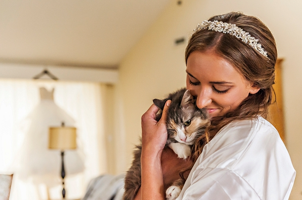 A bride and her kitty cat on the wedding day