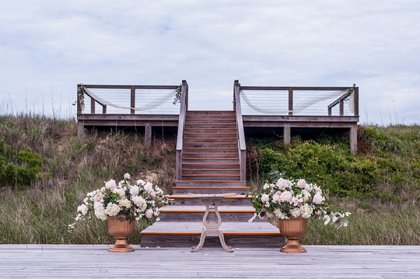 Two large floral urns for beach wedding ceremony setup