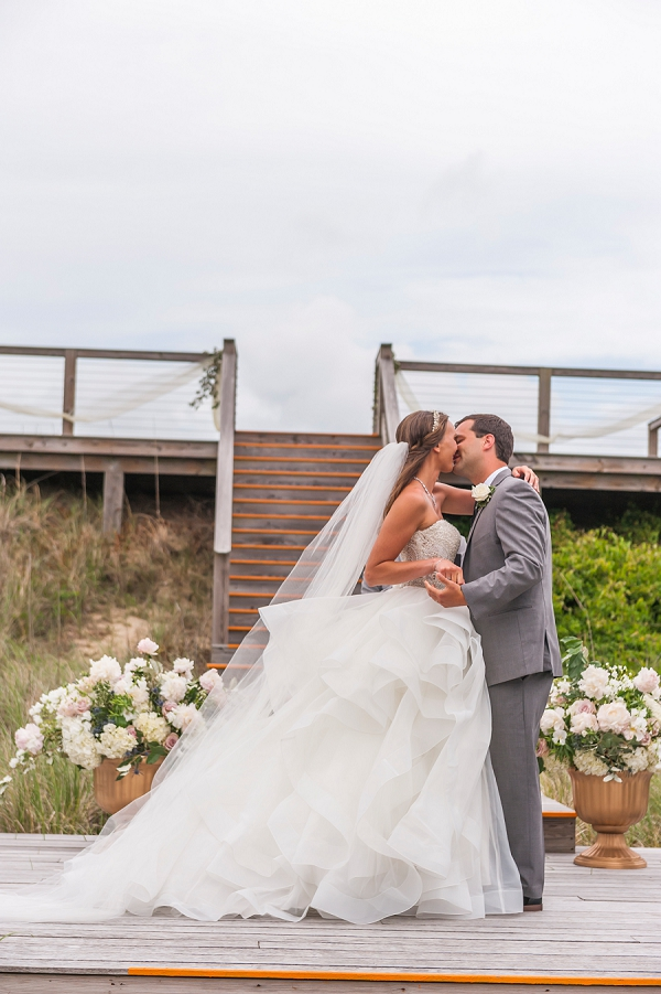 Bride and groom share a kiss at Sandering Resort in Duck North Carolina
