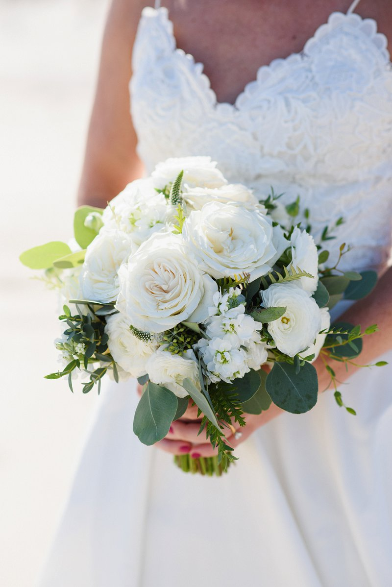 Textured white bridal bouquet with ranunculus and roses