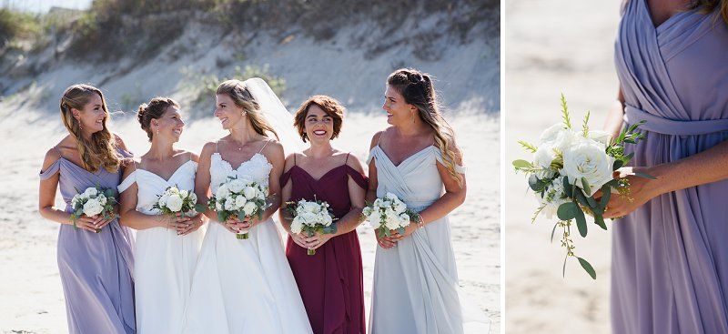 Bridesmaids with different colored dresses for a chic beach wedding