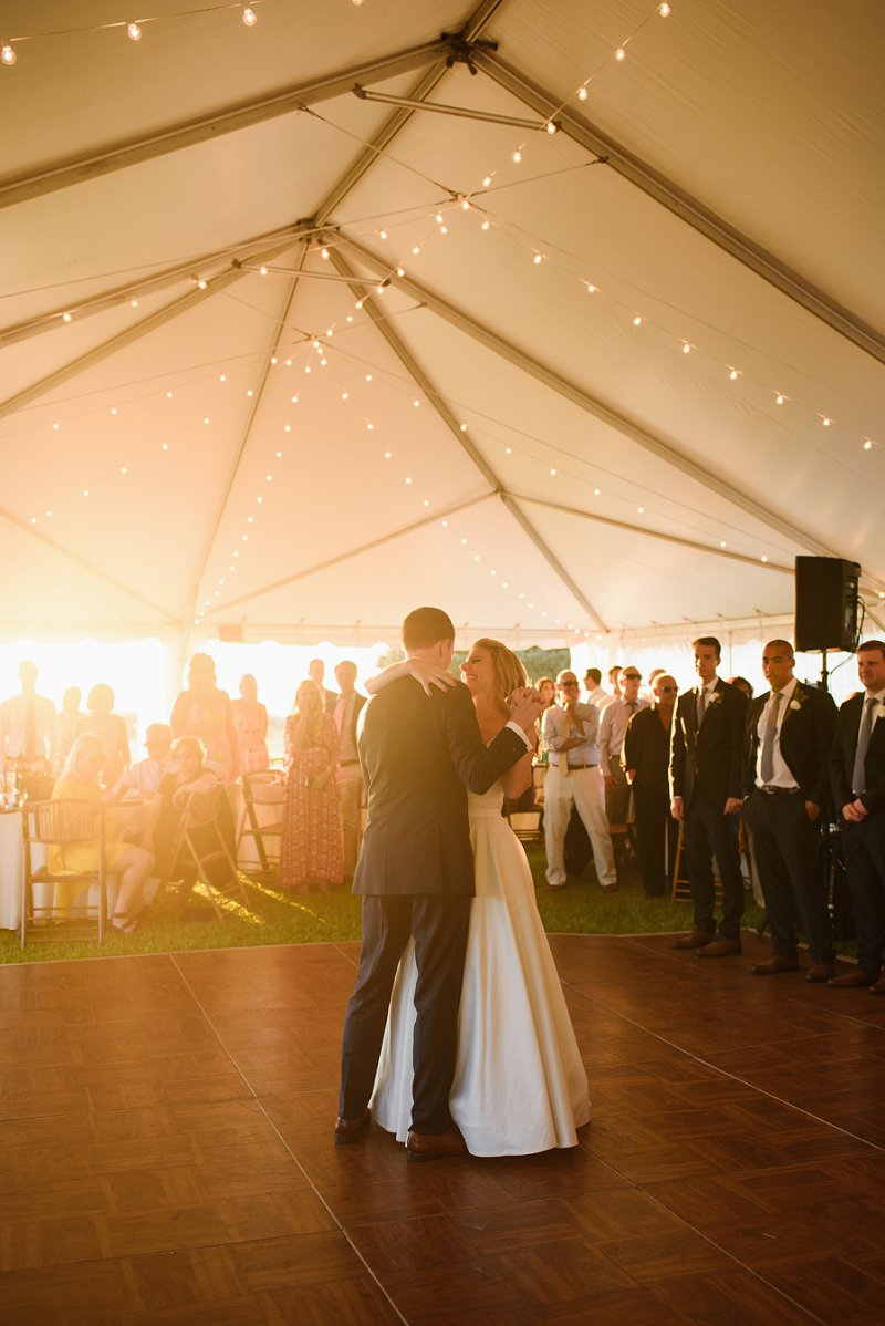 Sunset lit first wedding dance at Whalehead Club for romantic beach wedding in Outer Banks