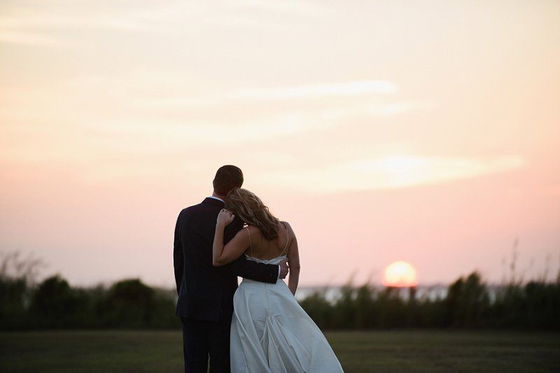 Beautiful sunset moment with bride and groom at Whalehead Club in Outer Banks North Carolina