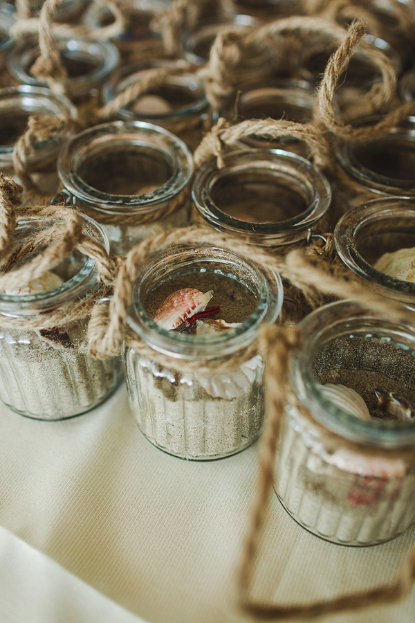 Beach wedding favors of glass jars with local beach sand
