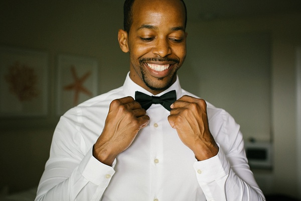 Stylish groom with black bow tie