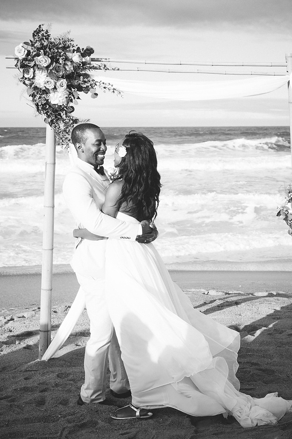 Intimate Outer Banks wedding ceremony with bamboo arch