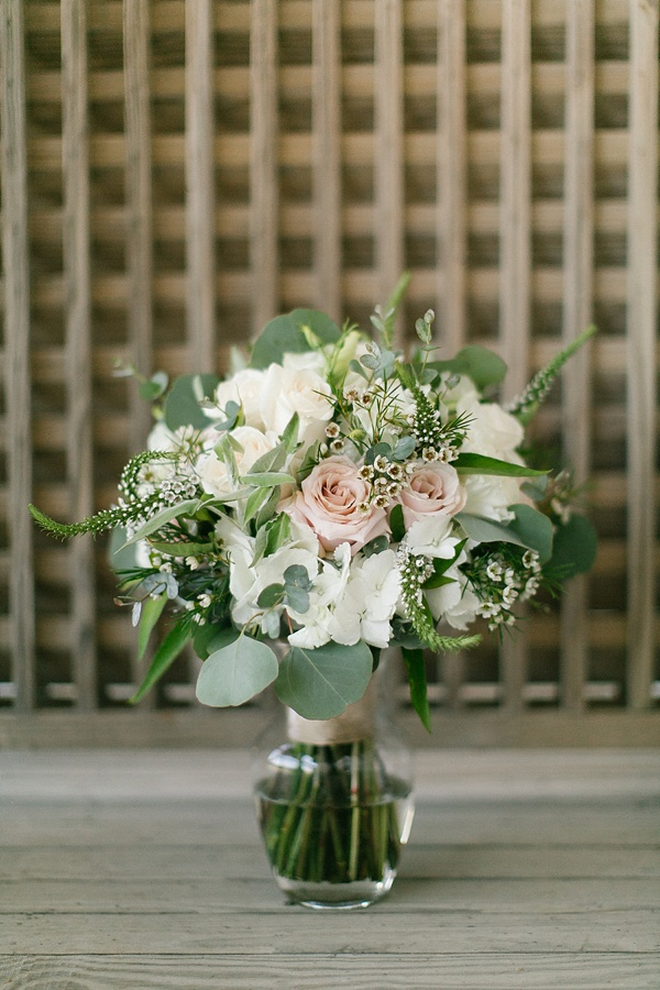 Textured wedding bouquet with roses and veronica flowers