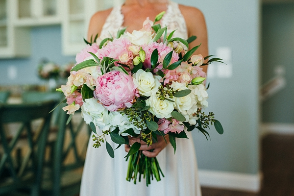 Pink and white wedding bouquet full of peonies