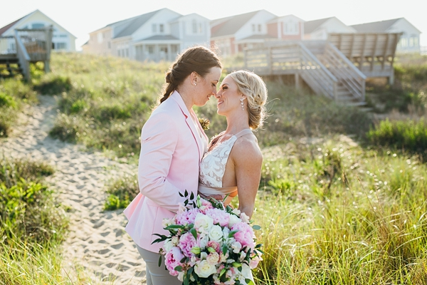Romantic beach wedding portrait with two brides