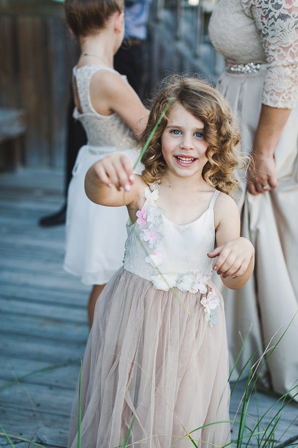 Flower girl junior bridesmaid in neutral color tulle dress