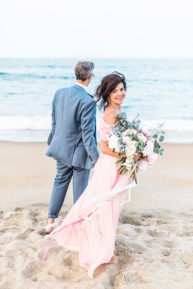 Beach bride and groom with flowy pink dress and bouquet in the Outer Banks