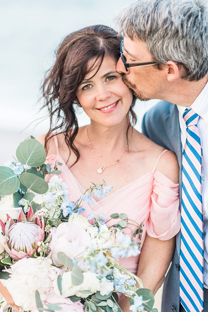 Beautiful bride with pastel pink dress and natural makeup perfect for a beach wedding vow renewal