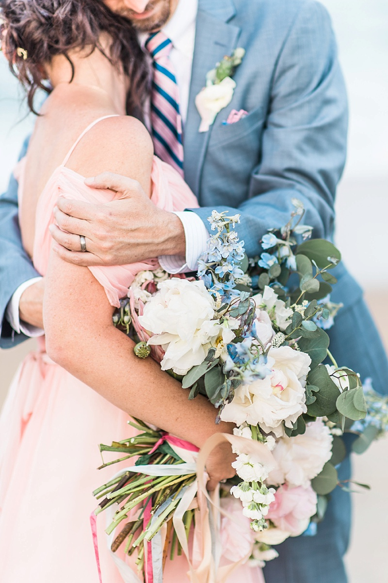 Pretty king protea wedding bouquet with pastel pink and blue colors for beach celebration