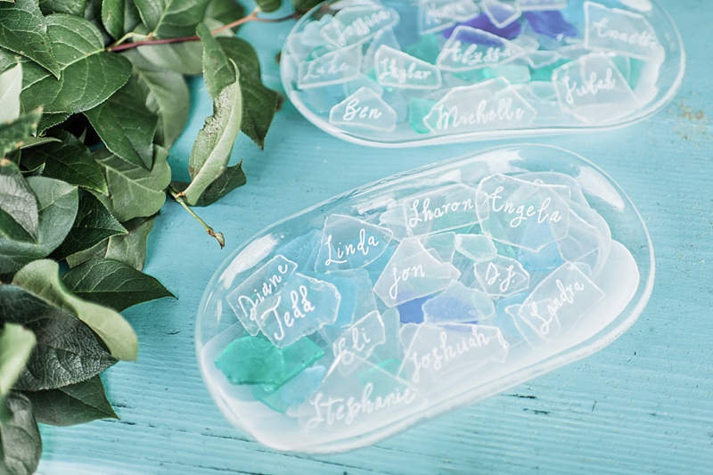 Blue and white sea glass wedding place cards for beach wedding reception