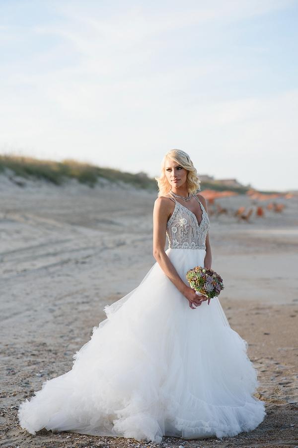Glam beach bride in a Hayley Paige wedding dress