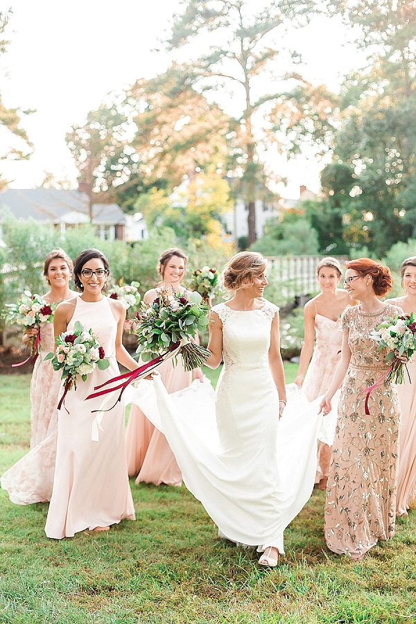 Bridesmaids in sparkly and pastel pink mismatched BHLDN dresses