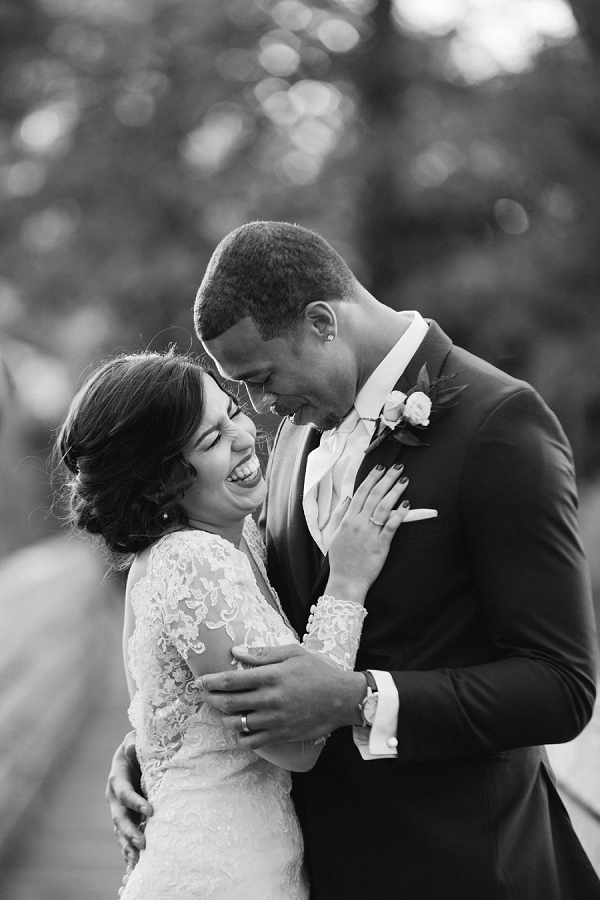 Beautiful black and white portrait of bride and groom embracing