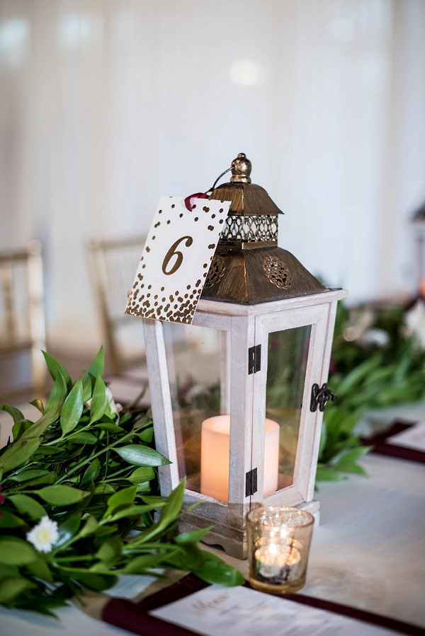 Brass and white lantern for wedding table numbers