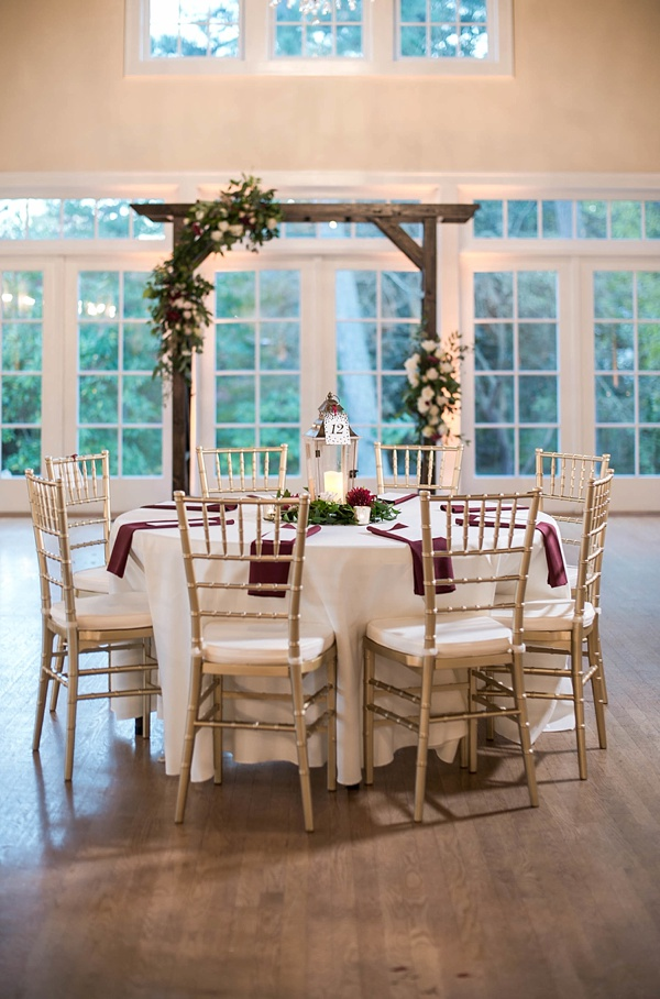Gold chiavari chairs with lantern centerpiece for fall wedding