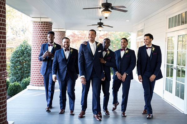 Handsome groomsmen in navy blue suits