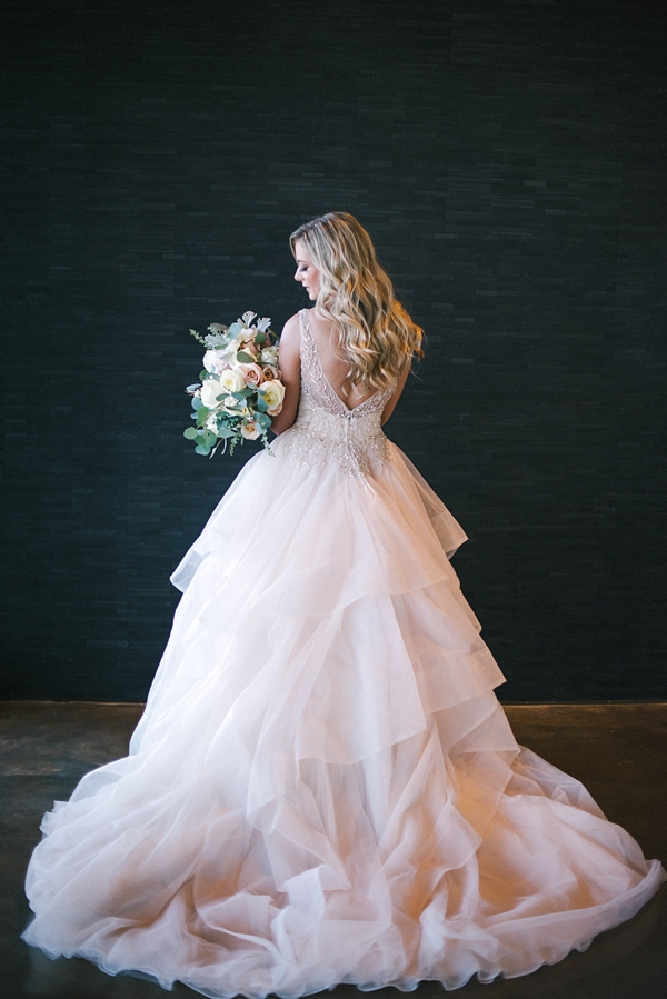 Gorgeous blush pink wedding dress with tiers of ruffles