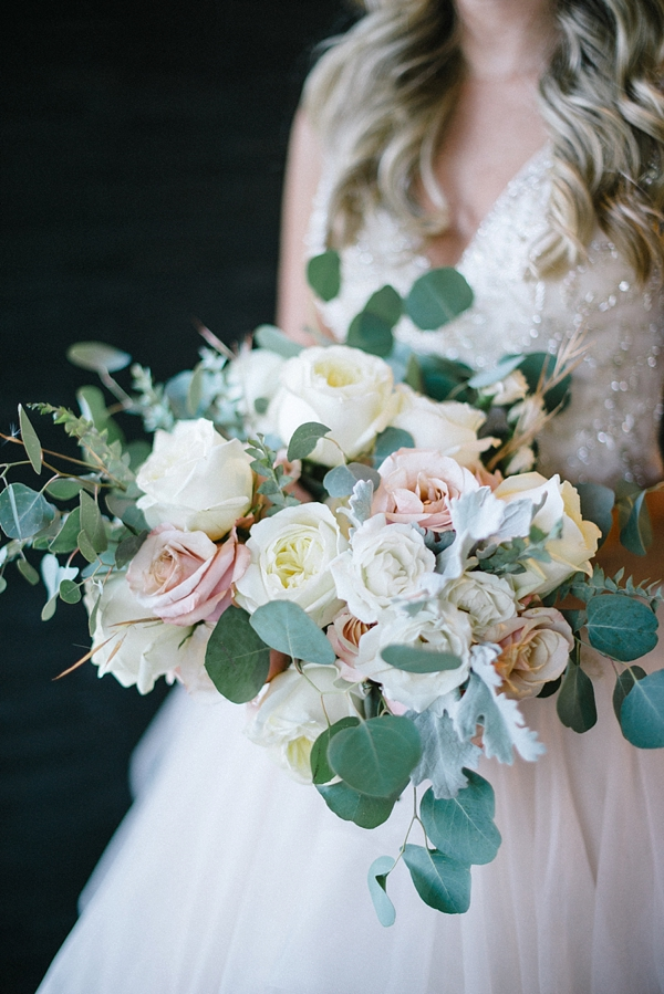 Romantic wild bouquet of roses and eucalyptus