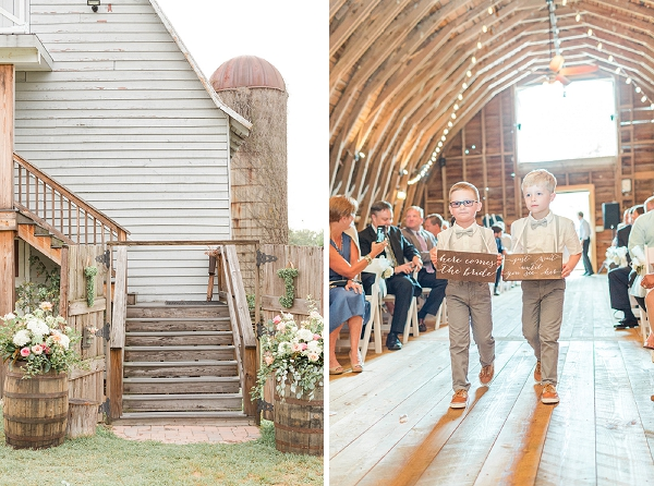 Adorable ring bearers carrying wooden signs for barn wedding ceremony