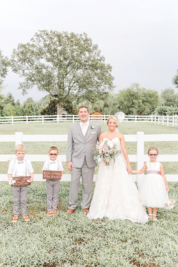 Adorable bride and groom portrait with their little flower girl and ring bearers at Amber Grove