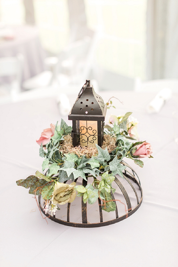 Metal lantern and round bowl with dried flowers for rustic wedding centerpiece