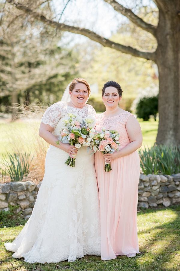 Peach colored bridesmaid dress and succulent bouquets