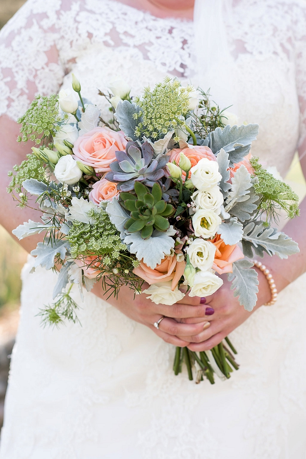Gorgeous bridal bouquet with succulents and roses