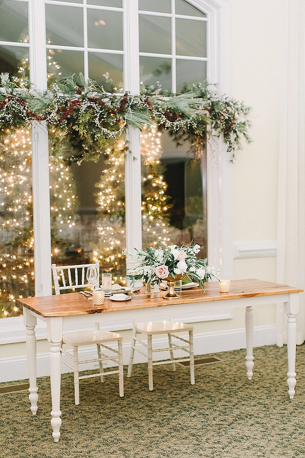 Sweetheart wedding table with winter berry arch and vintage furniture