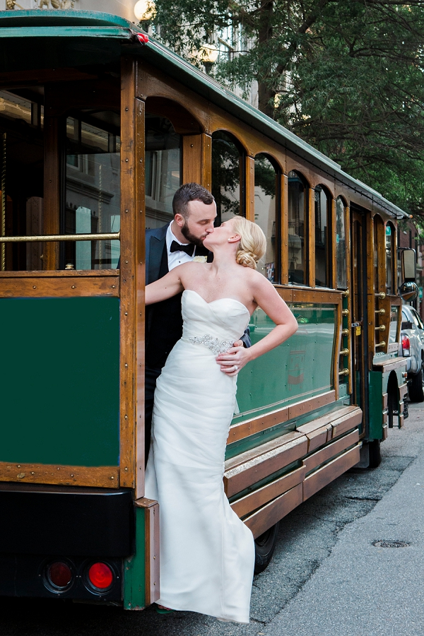 Bride and groom on green trolley