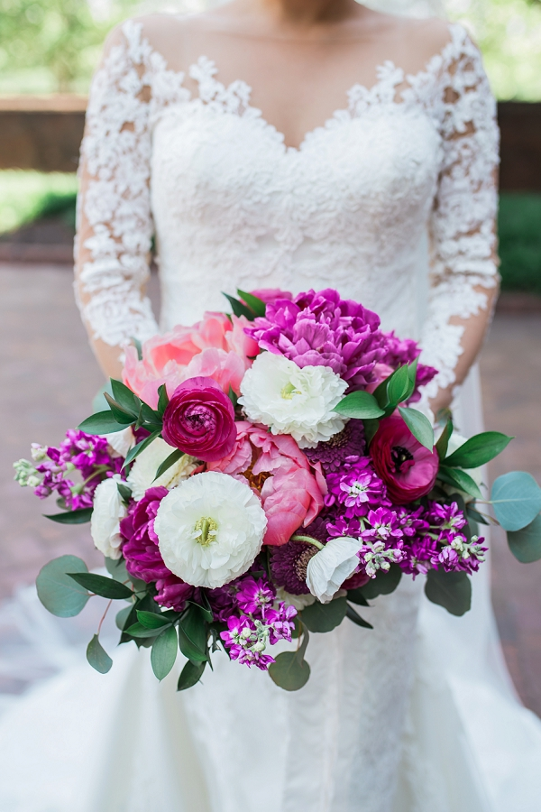 Fluffy pink and white bridal bouquet filled with peonies and poppies