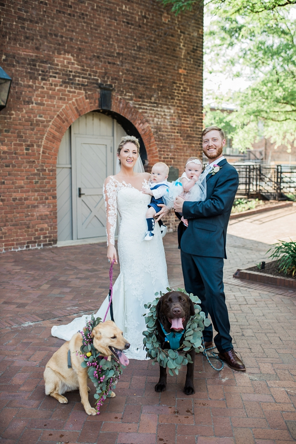 Bride and groom with their twins and doggy children