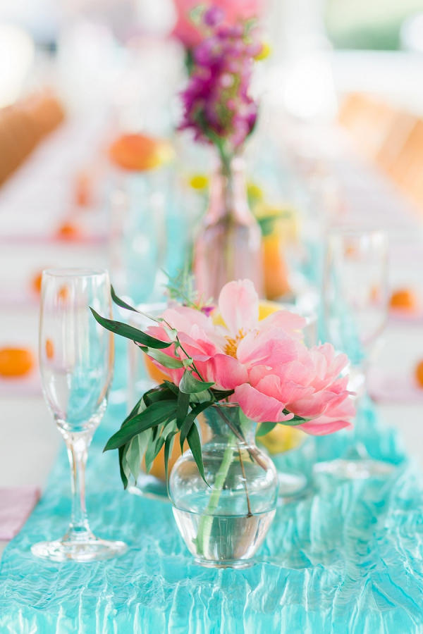 Simple flower centerpieces with lemons and limes for summer citrus wedding ideas