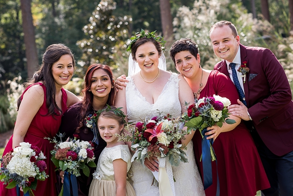 Gorgeous autumnal wedding party dressed in crimson red and navy blue at Brandermill Country Club in Midlothian Virginia