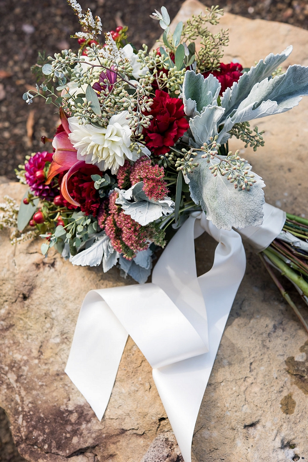 Fall wedding bouquet with dark red flowers and dusty miller