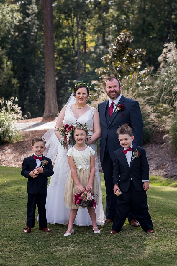 Bride and groom with their ring bearers and flower girl at Brandermill Country Club in Midlothian Virginia