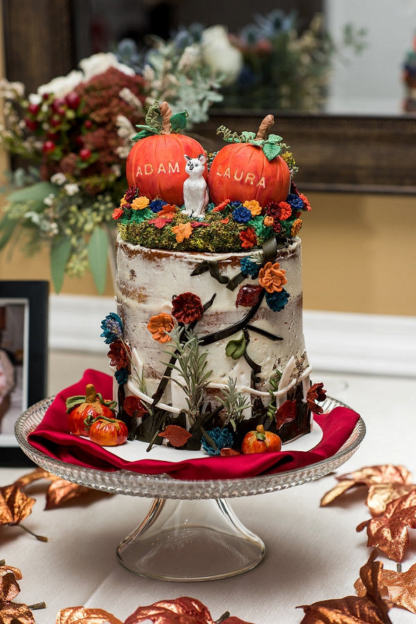 Cute colorful fall wedding cake with cat cake topper