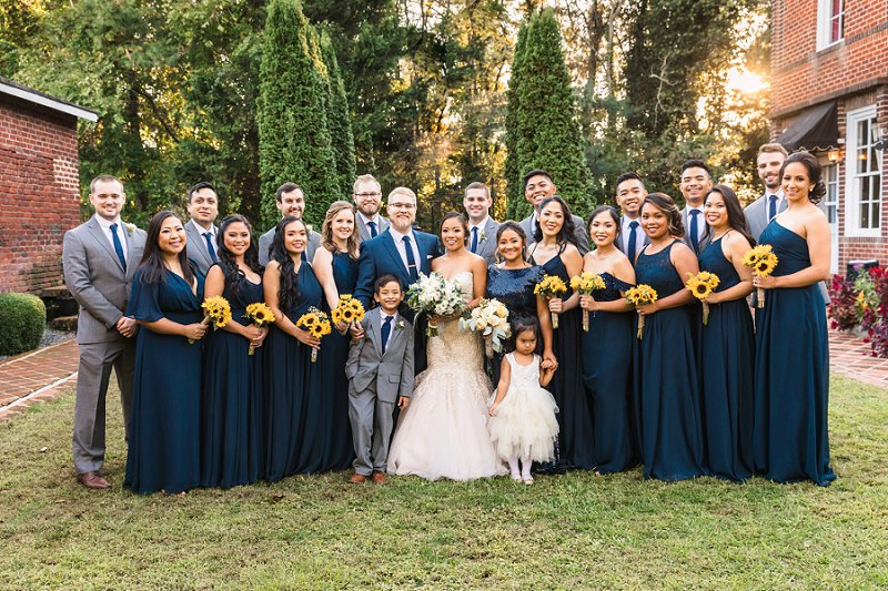 Large wedding party with bridesmaids and groomsmen in gray and navy blue for a Filipino wedding in Richmond Virginia