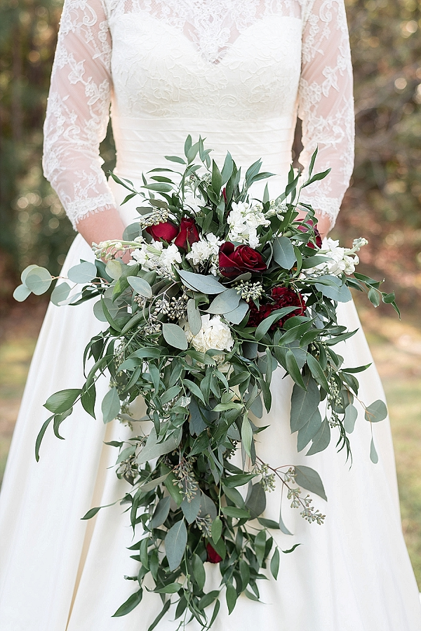Gorgeous cascade wedding bouquet of eucalyptus and red roses